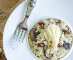 Risotto aux champignons, à la tête de moine lamelles de truffe et éclats de foie gras
