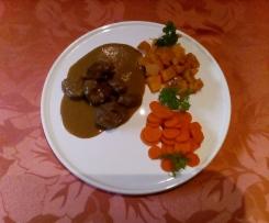 Joues de porc sauce chocolat carottes et patates douces