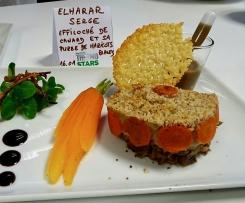 Effiloché de canard et purée de haricots blancs, sa chips de parmesan et sa sauce aux cèpes accompagné de mache et de pelures de carottes séchées