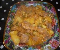 Rouelle de porc , pomme de terre poivron